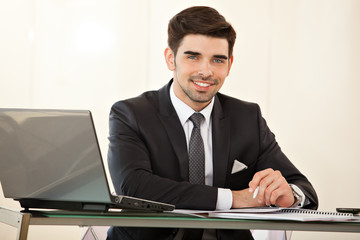 handsome business man with laptop