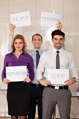team of business people holding card boards