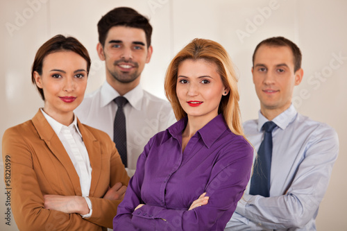business people smiling  with arms crossed