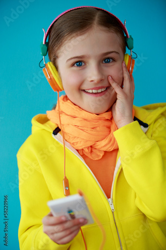 Young girl enjoying music