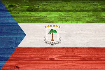 Equatorial Guinea Flag painted on old wood plank background.