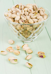 Pistachios - Roasted and salted pistachio nuts in a glass bowl