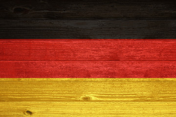 Germany Flag painted on old wood plank background.
