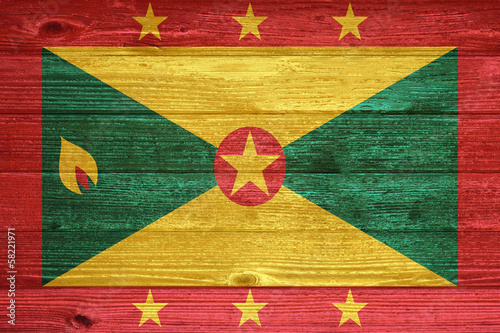 Grenada Flag painted on old wood plank background.