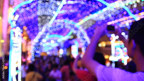 People walking and take photo in festival, defocused