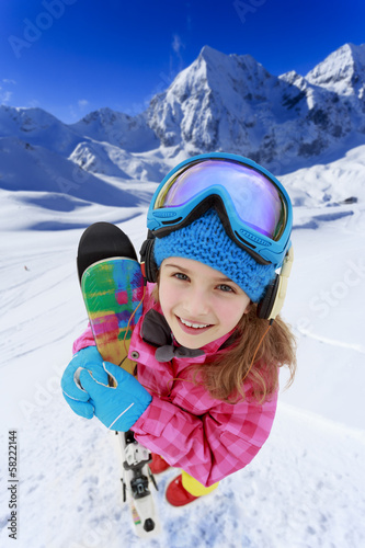 Ski, skier, winter - lovely girl has a fun on ski