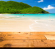 Warm sandy beach in caribbean by wooden decking