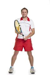 junger Mann beim Tennis Aufschlag