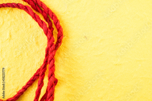 red mulberry paper rope on yellow background