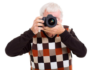 elderly man taking photos