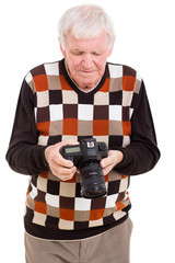 senior man reviewing pictures on camera