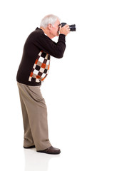 elderly man shooting with digital SLR camera