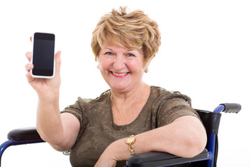 elderly woman in a wheelchair showing a smart phone