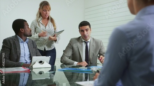 team of business people working in office meeting room