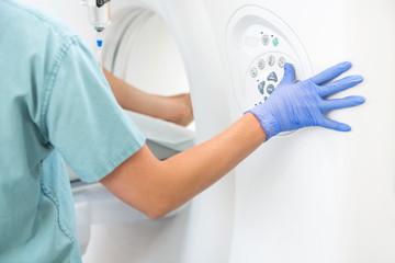 Nurse Operating CT Scan Machine