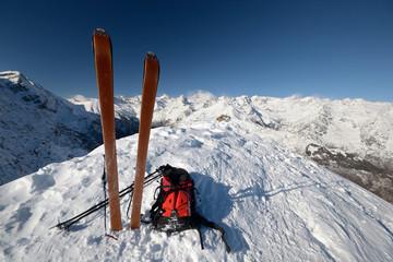 On the mountain peak by ski touring