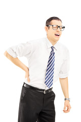 Young man with tie suffering from a back pain