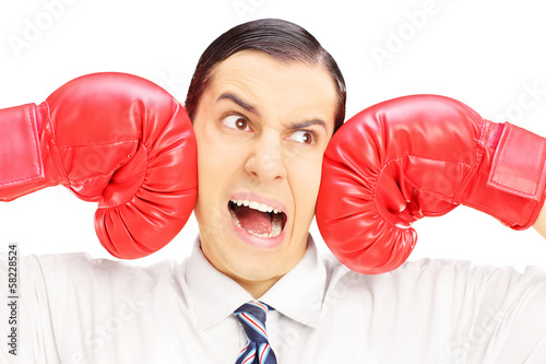 Young man punched by red boxing gloves