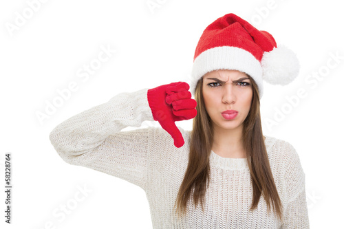 Sad young woman showing thumb down