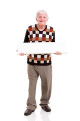 senior man holding white board