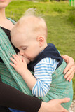 Breastfeeding in baby sling outdoors