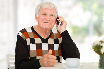 senior man talking on cell phone