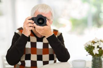senior man taking photos