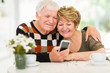 elderly couple using smart phone