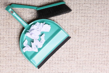 Green sweeping brush dustpan with garbage, housework