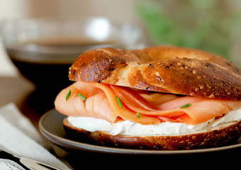 smoked salmon and cream cheese bagel with coffee.
