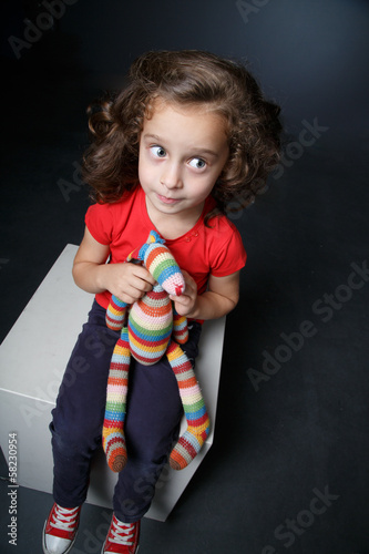 Portrait of a girl with a toy