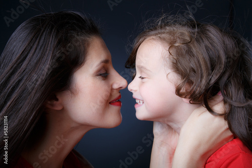 Mother touches noses with her daughter