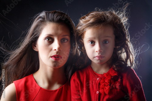 Artistic portrait of mother and daughter