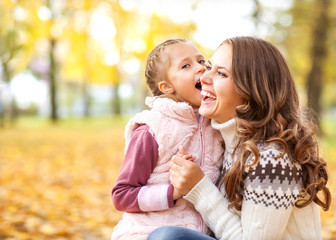 Young mother and her toddler girl have fun in park