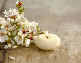 bunch of spring flower with candle on old wooden