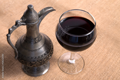Simple View Of Pewter Flagon and Red Vine in the Glass