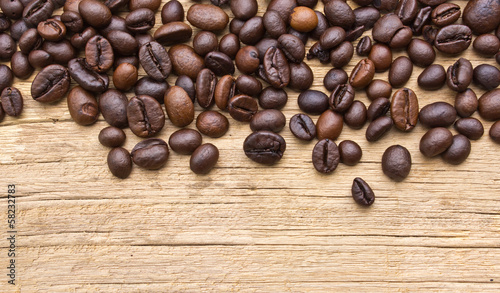 Fresh coffee beans on wood, ready to brew delicious coffee
