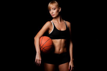 woman standing with basketball
