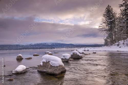 Idaho mountain lake in the winter with rocks and snow