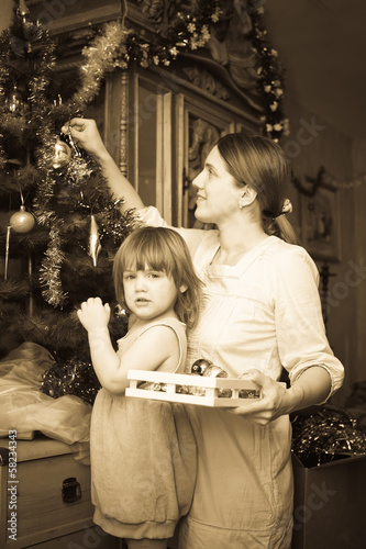 mother and child preparing for  Christmas at home