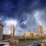 Fototapety Escaping from city severe weather. Cars speeding up with lightni