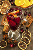 Mulled wine with slice of orange and spices