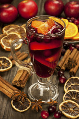 Christmas still life with glass of mulled wine