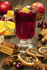 Glass with mulled wine and spices
