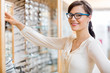 Happy Woman Buying Glasses At Optician Store
