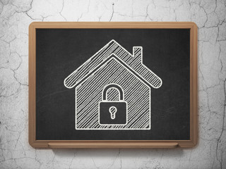 Security concept: Home on chalkboard background