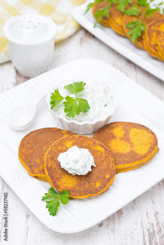 Pumpkin fritters with fresh herbs and feta sauce
