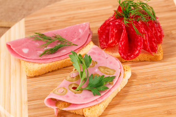 Sandwiches with salami and mortadella