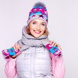 Happy adult girl in winter clothes with bright positive emotions