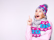 happy surprised woman in winter clothes with positive emotions